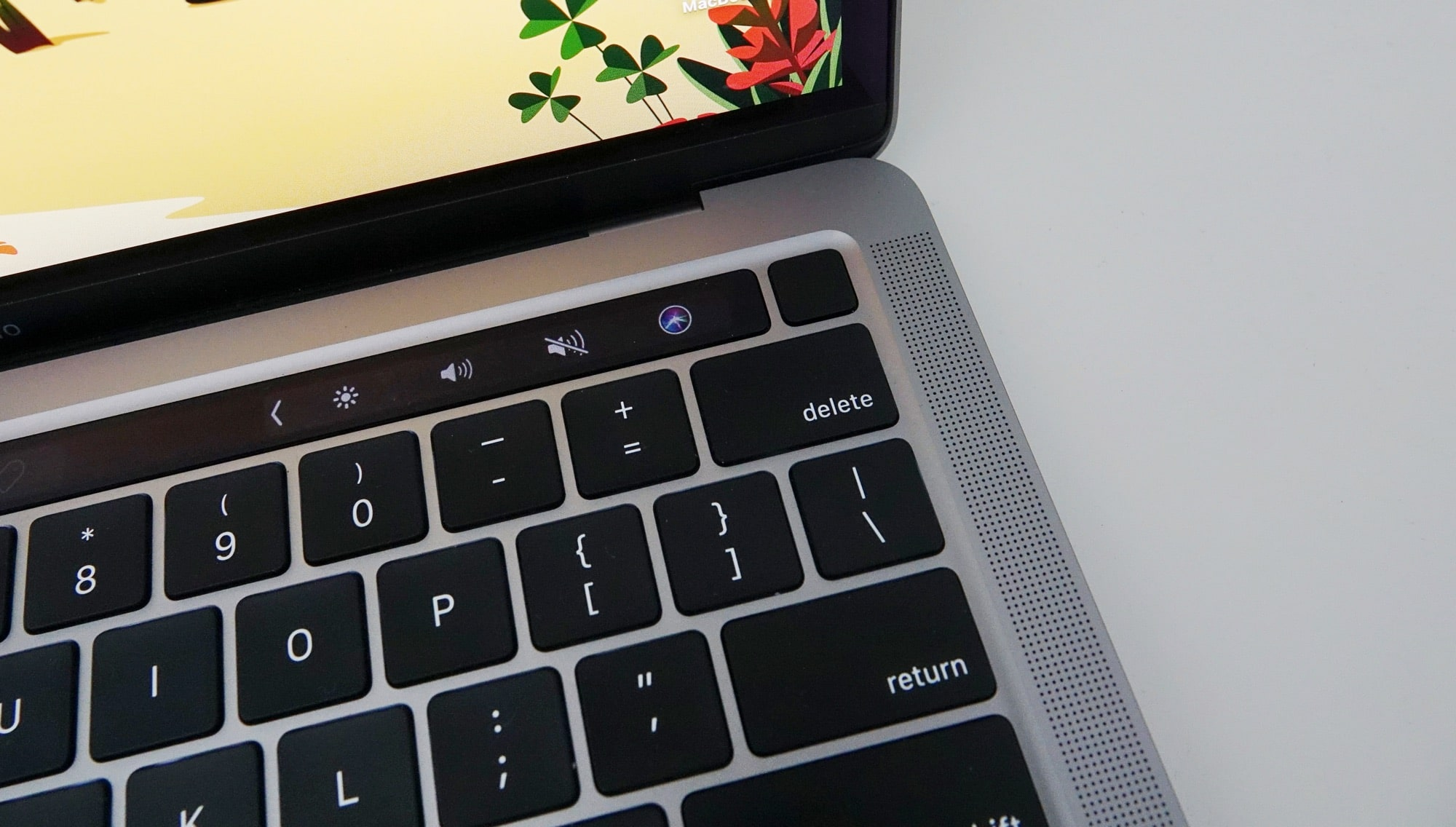 The fingerprint sensor next to the OLED Touch Bar on the 13 inch M1 MBP