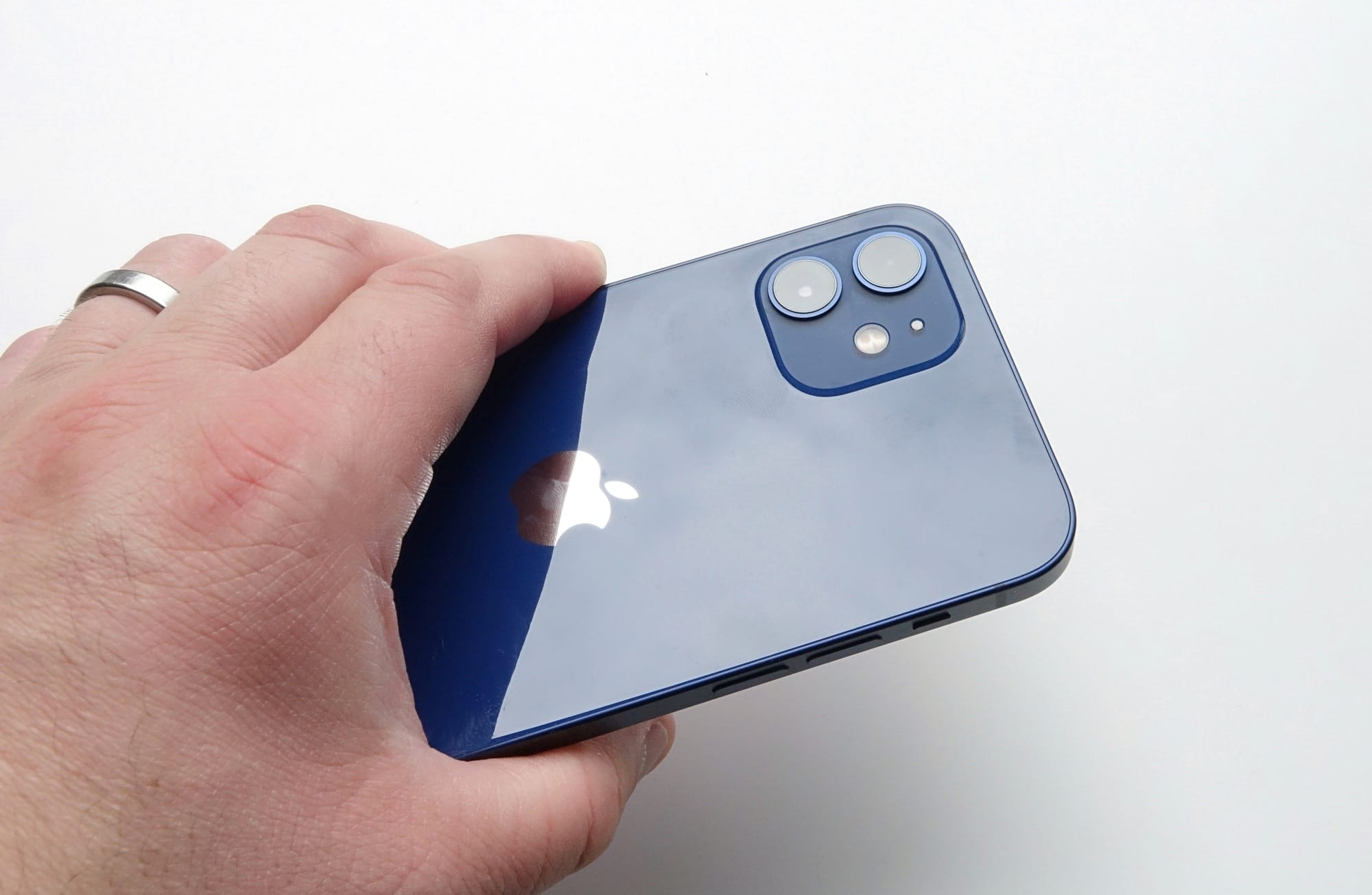 Holding the iPhone 12