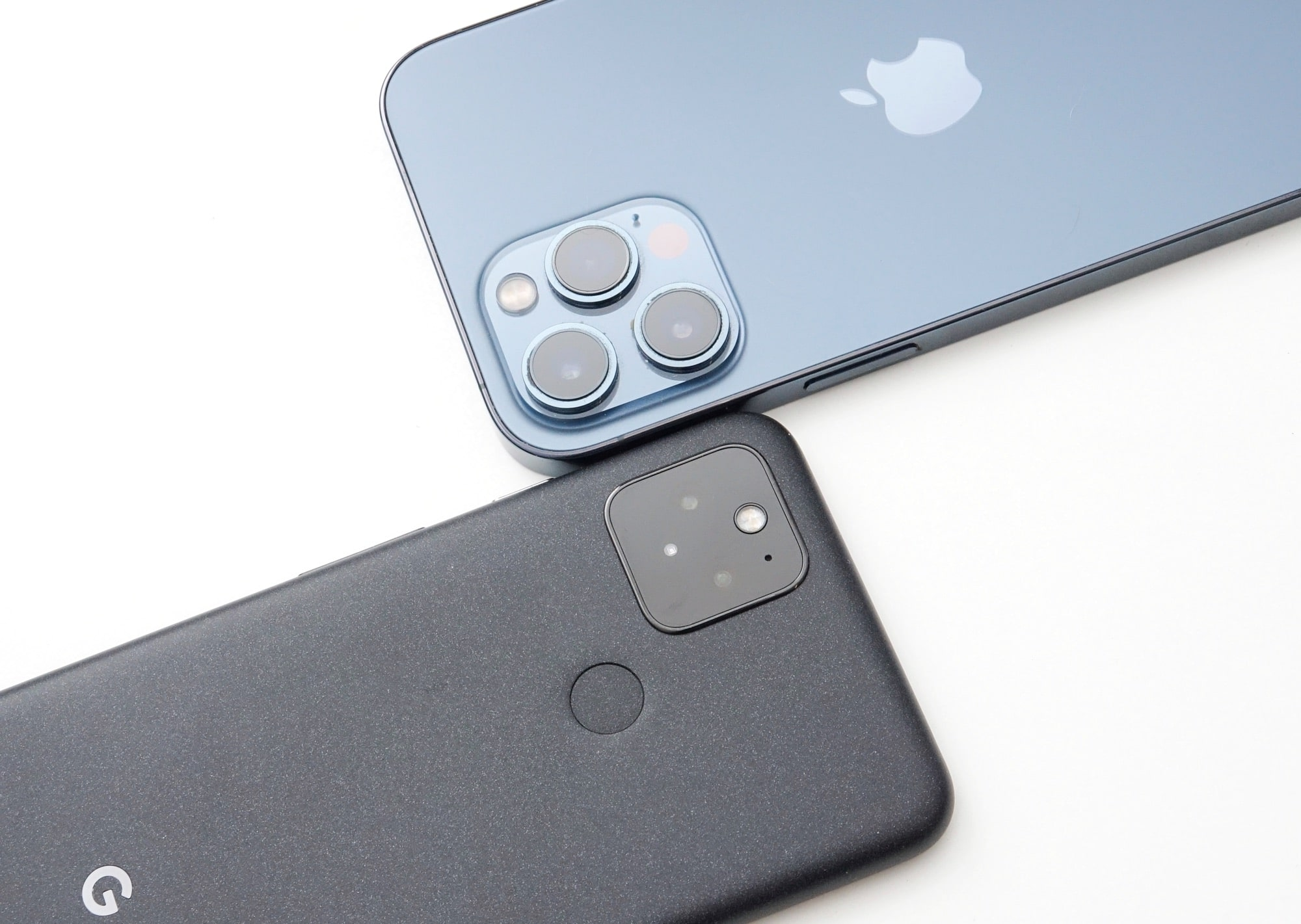 Head to head: the Google Pixel 5 (left) vs the Apple iPhone 12 Pro Max (right)